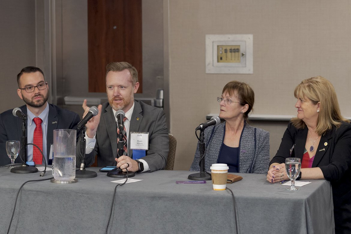 Panelists taking part in a discussion