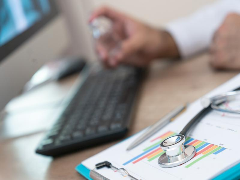 Doctor at computer keyboard