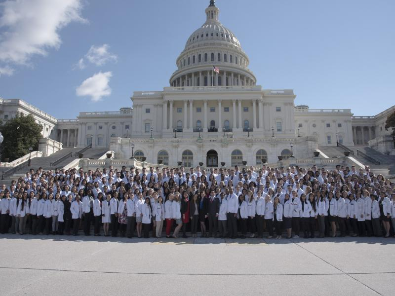 A photo of a large group of physicians at the Capitol Building in Washington, D.C.