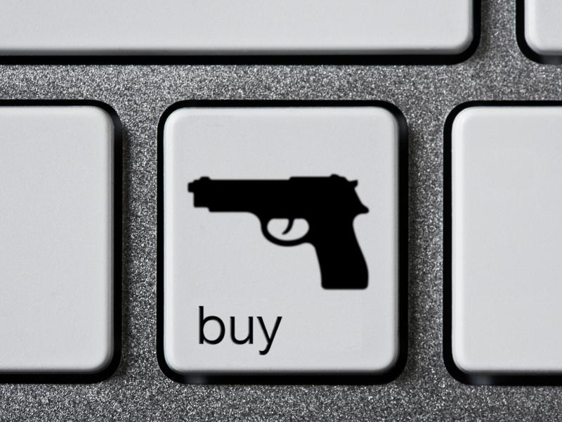 Keyboard button with a gun on it