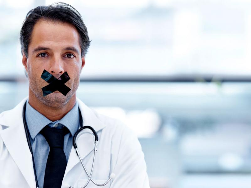 Physician with tape over his mouth