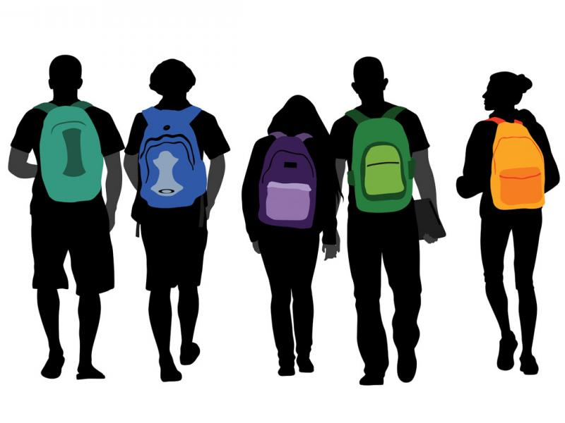 Students with colorful backpacks walking in a group
