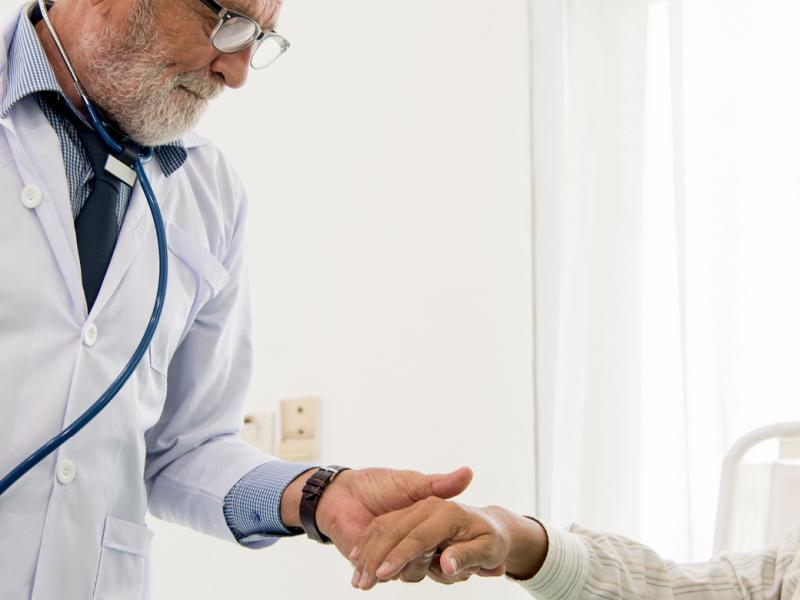 Physician holding a patient's hand