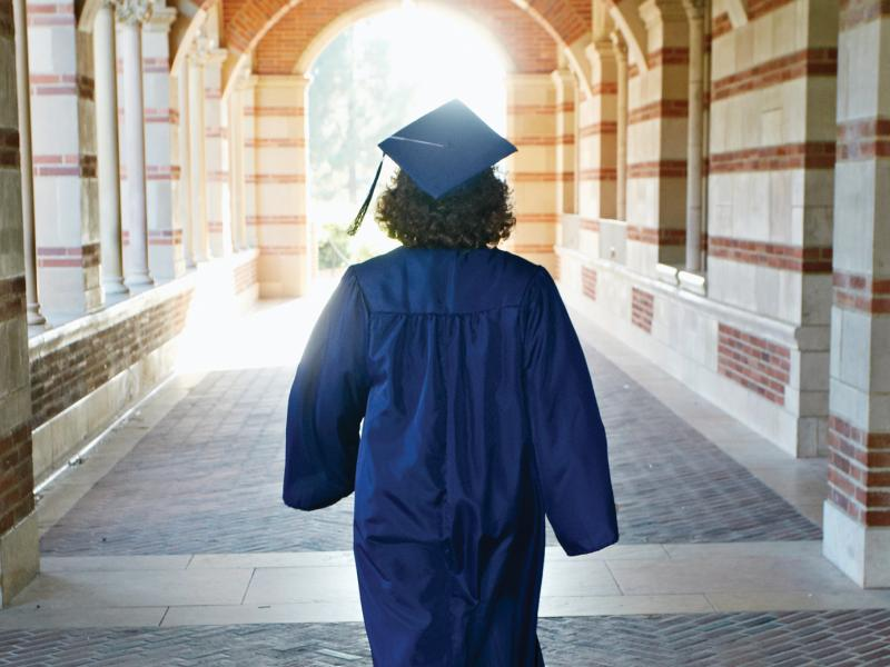 Graduate wearing a cap and gown