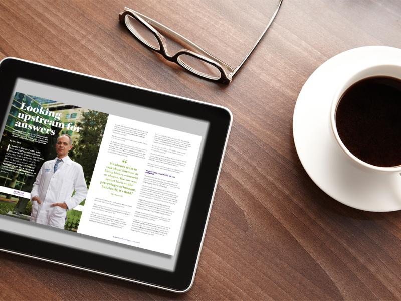 Tablet on a table with a cup of coffee and reading glasses