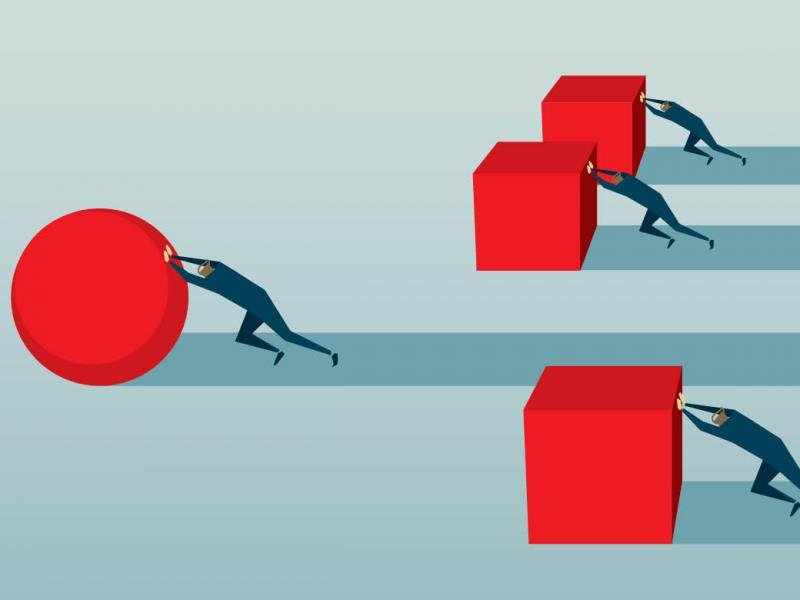 Illustration of figures pushing blocks