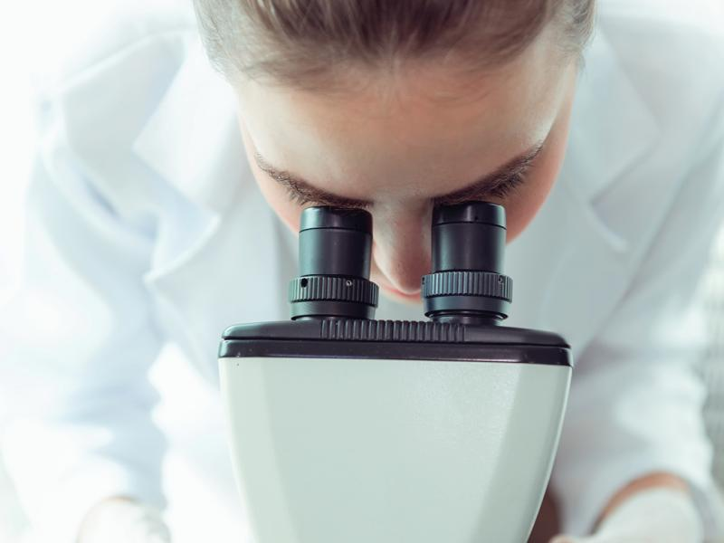 Woman using a microscope