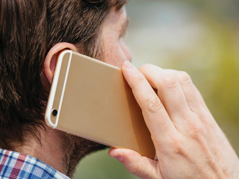 Man with cell phone to his ear