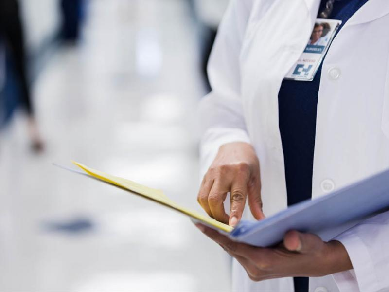Physician looking at file
