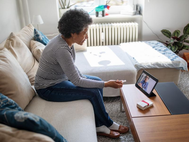 Patient and physician in a telehealth appointment
