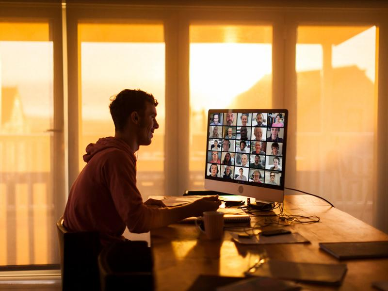 Person attending a virtual meeting on computer