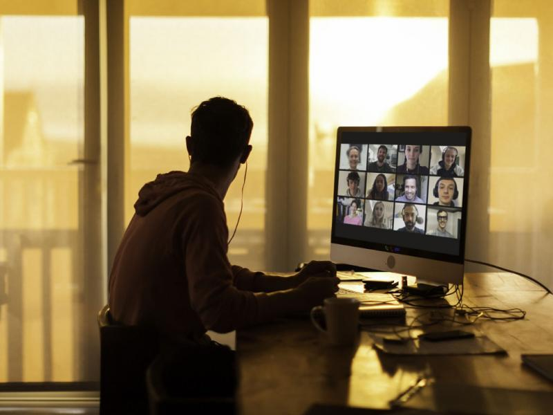 Person having a virtual meeting on a desktop