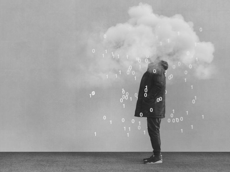 "Photo illustration of a person with their head in a ""data cloud"" of ones and zeroes."