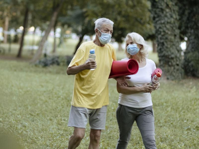 Couple wearing face masks outside