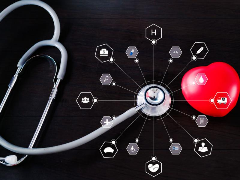 Stethoscope with red heart and icon medical network connection.