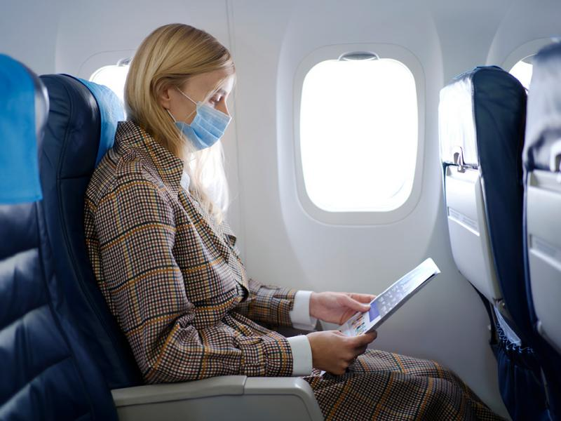 Airplane passenger wearing a face mask