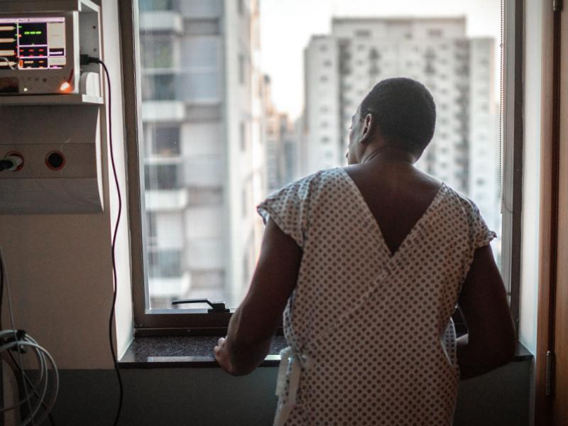 Person in hospital room looking out the window