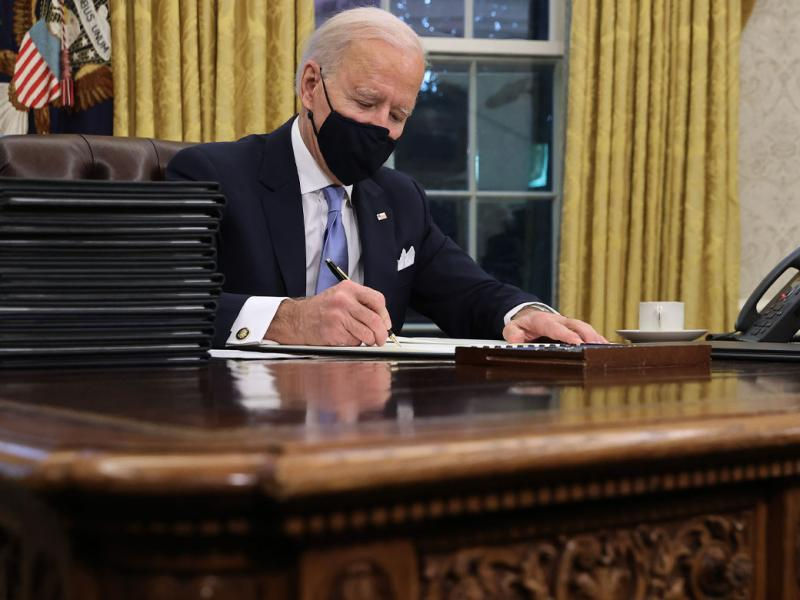 U.S. President Joe Biden prepares to sign a series of executive orders