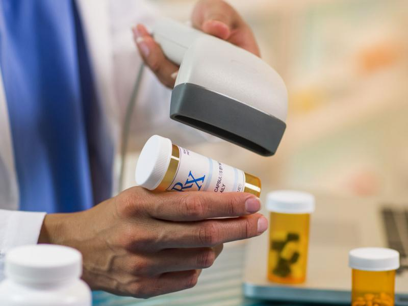 Hand scanning a prescription bottle