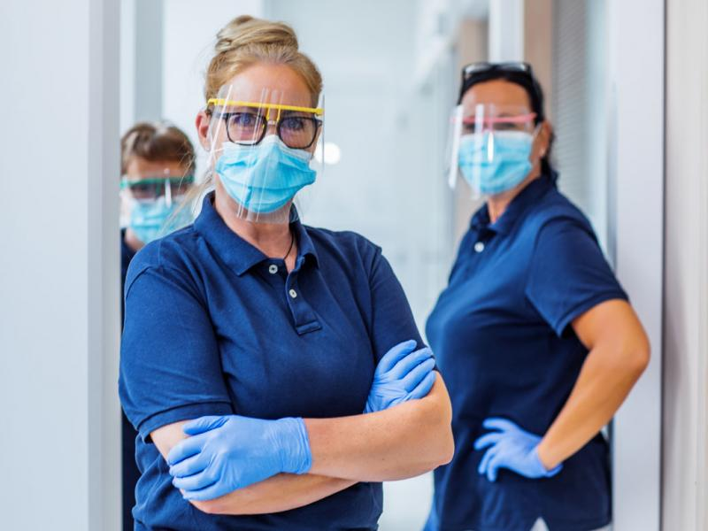 Three health care workers in PPE