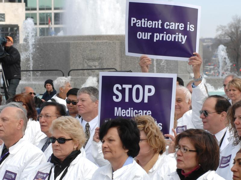 physicians with signs advocating patient care