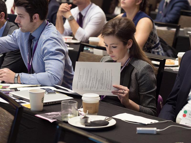A resident reads a handout during the HOD Annual Meeting.