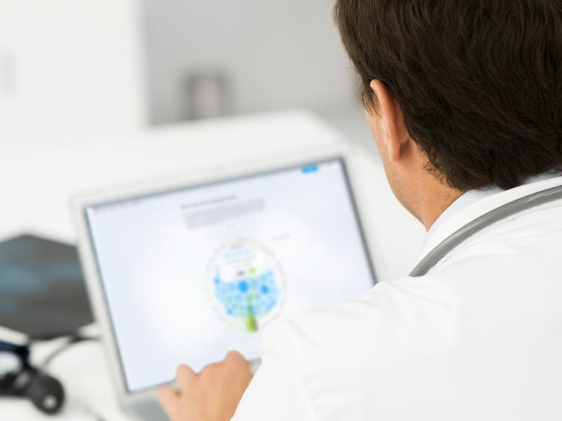 Physician doing research on a computer.