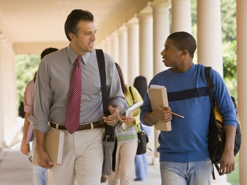 Student walking with instructor and having a conversation.