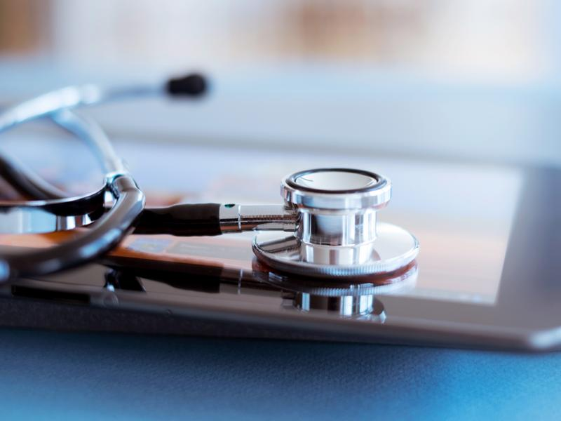 Closeup of stethoscope and tablet.