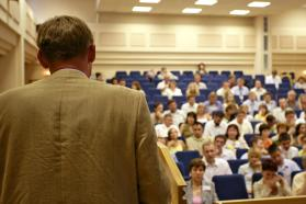 Physician presenting to a crowded auditorium