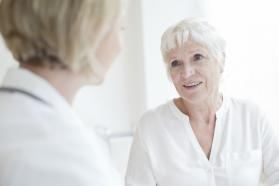 An older woman speaking with a physician