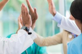 Medical professionals give high fives