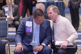 Two delegates consulting at 2018 AMA Interim Meeting