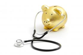 Piggy bank wearing a stethoscope