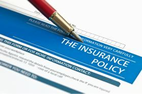Pen placed on insurance policy form