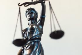 A statue holding the scales of justice