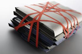 File folders bound in red tape