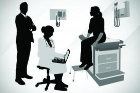 Doctor and patient in exam room with man looming in background