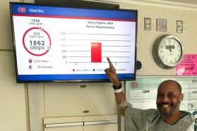 Patient pointing at his steps progress on a screen