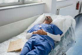 Physician napping on a hospital bed