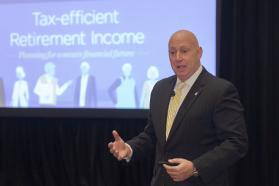 Tax-efficient Retirement Income slide displayed during a presentation by Carlo Cordasco, vice president of Nationwide Retirement Institute