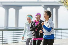 Three smiling women in workout clothes