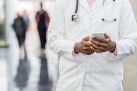 Physician holding a smartphone