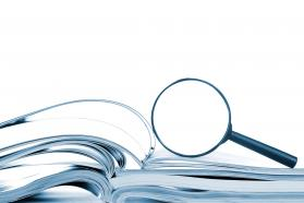 Magnifying glass resting on books