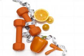 Weights, tape measure, fruits, and vegetables grouped