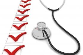 Stethoscope next to a line of checkboxes