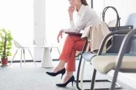 Woman sitting in a waiting room