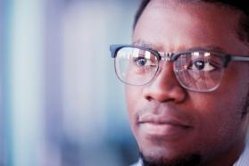 Close up of a man wearing glasses