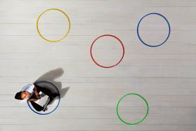 Woman surrounded by different colored circles
