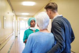 Physician talking to family in hallway